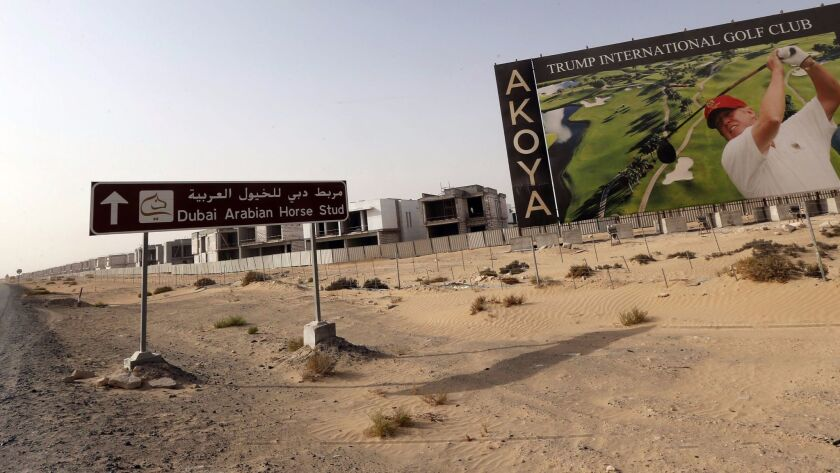 An image of Donald Trump playing golf is featured on a billboard at Trump International Golf Club Dubai, under construction in the United Arab Emirates, in 2015.