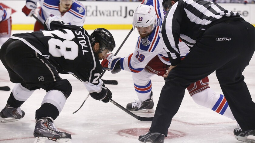 Kings center Jarret Stoll, left, faces off against New York Rangers center Brad Richards during the Kings' double-overtime win in Game 2 of the Stanley Cup Final at Staples Center on Saturday. Stoll is one of NHL's best at winning faceoffs.
