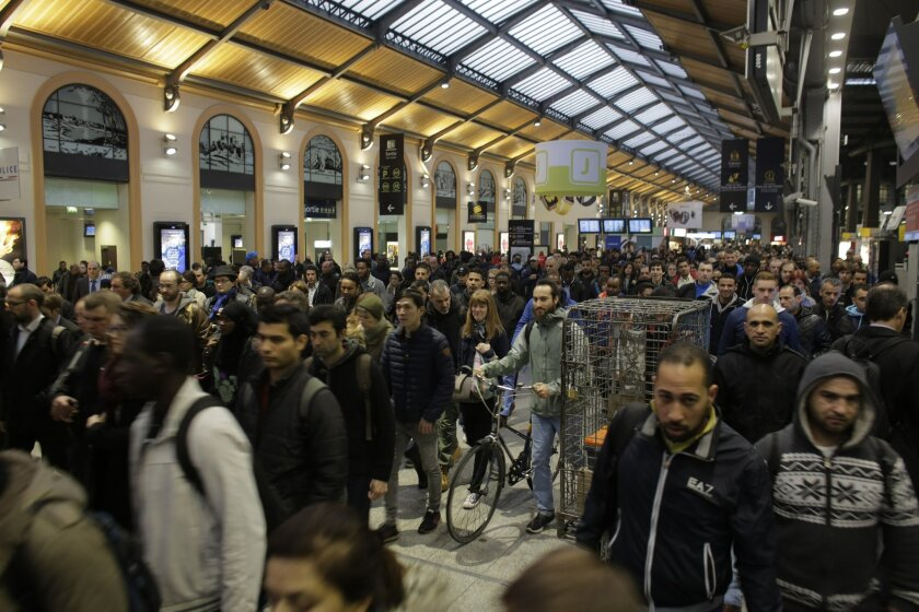 Commuters head to one of the few trains running after a strike starts at the Gare Saint Lazare train station, in Paris, Wednesday, June 1, 2016. Workers at the SNCF national rail authority, whose train service will be crucial to the upcoming Euro 2016 football championship spectators, are on an ope
