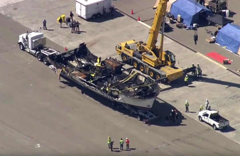 The burned hull of the Conception sits atop a big rig trailer at Port Hueneme after being raised from the ocean floor off Santa Cruz Island on Sept. 12.