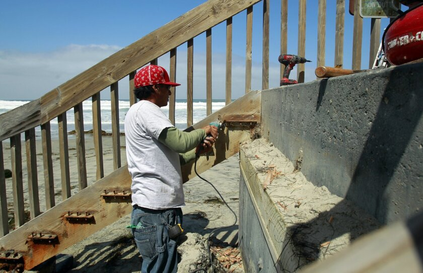 Jimmy Jimenez repairs a staircase at San Elijo State Beach.