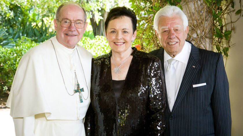 Abbot Eugene Hayes with donors Marybelle and S. Paul Musco prepare for the upcoming March 18th gr