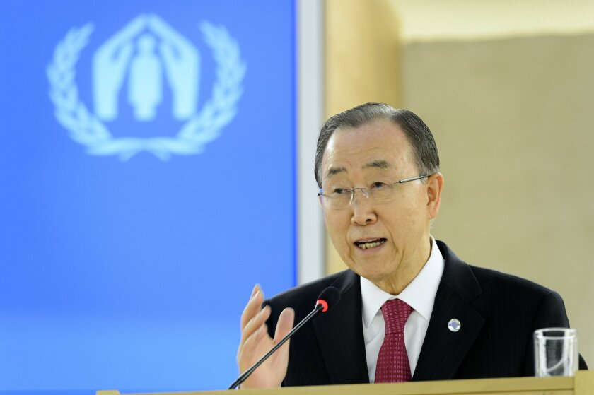 """United Nations Secretary General Ban Ki-moon delivers a speech during a one-day conference meant to further efforts to resettle Syrian refugees at the United Nations in Geneva, Switzerland, Wednesday, March 30, 2016. Ban Ki-moon is urging governments around the globe to let in more people from Syria and """"counter fearmongering"""" about refugees. (Martial Trezzini/Keystone via AP)"""