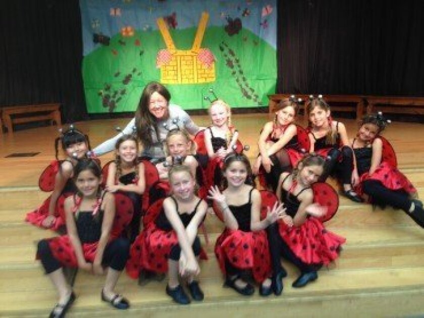 Mrs. Paige Rollins visiting her class and the ladybugs. Courtesy photo
