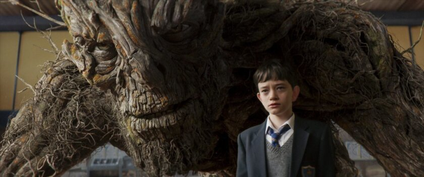 """Lewis MacDougall as Conor is shadowed by the Monster (performed and voiced by Liam Neeson) in J.A. Bayona's drama, """"A Monster Calls."""""""