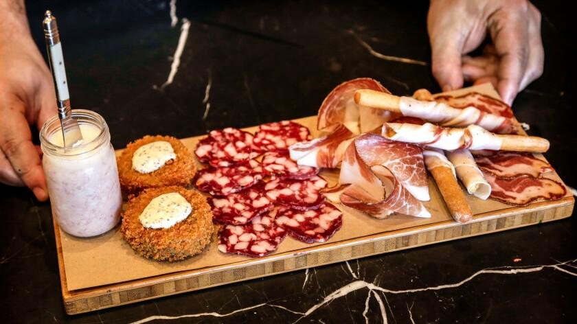 The Affettati Misti plate: Pork butter, Trotter Fritti, Trappist Salami, Joe's Tocai Salami, Speck, Lardo wrapped grissini and Capocollo.