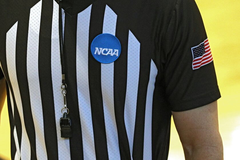 A CAA game official tested positive for the coronavirus.