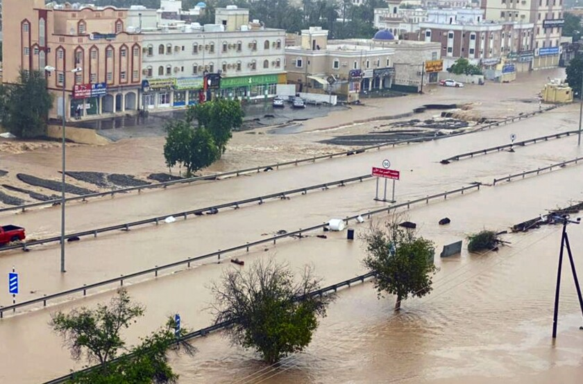 This photo released by Oman News Agency shows a flooded street of the Al Khaburah district after Cyclone Shaheen, in Oman, Monday, Oct. 4, 2021. The death toll from Cyclone Shaheen rose to over 10 Monday while other fishermen from Iran remained missing as the storm moved further inland into Oman and weakened. (Oman News Agency via AP)
