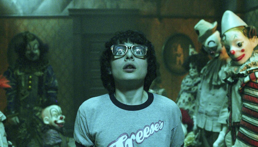 """This image released by Warner Bros. Pictures shows Finn Wolfhard in a scene from """"It."""" (Warner Bros."""