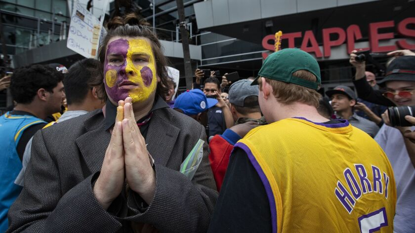 LOS ANGELES, CA-MAY 10, 2019: Diano Merchel, 18, of Los Angeles, left, wearing the team's colors on