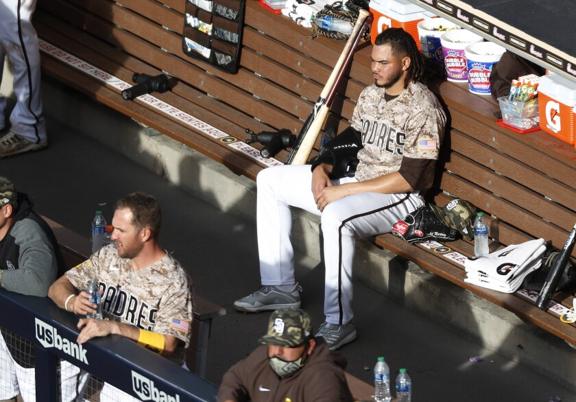 Dinelson Lamet sits on bench in between innings during the Padres game