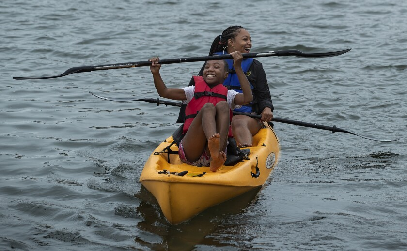 LeLe Jackson, front, and her cousin, Chey Lewis of Los Angeles, enjoy the paddling at Marina del Rey's Mother's Beach.