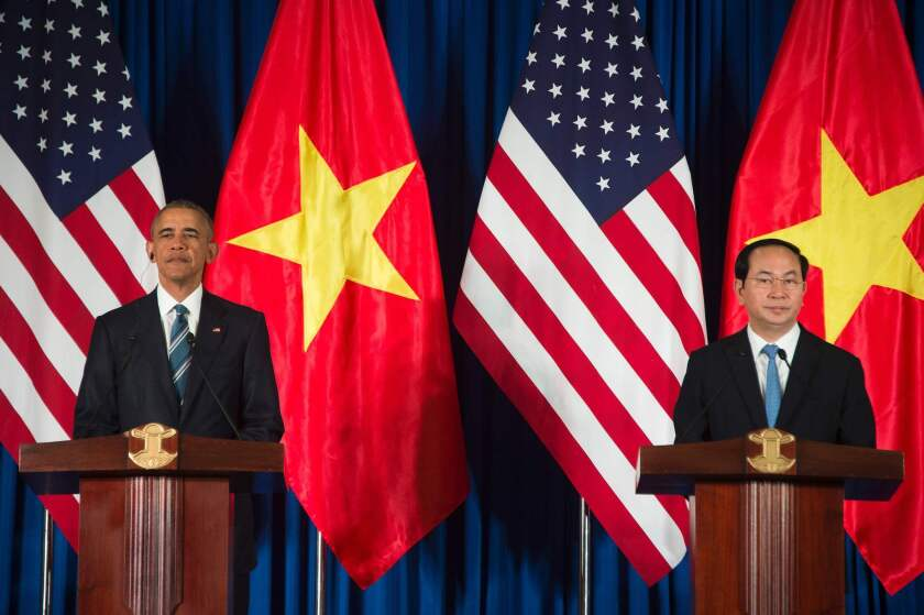 President Obama and Vietnamese President Tran Dai Quang speak during a joint news conference in Hanoi.