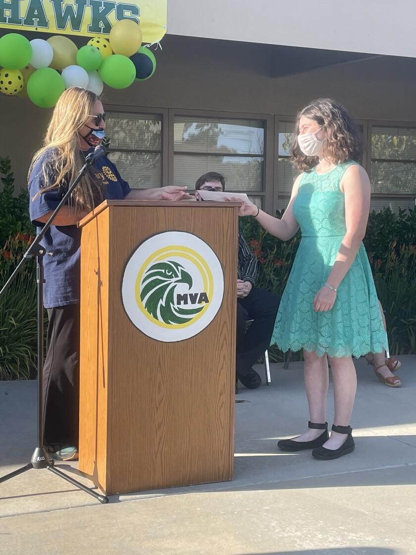 Tracey Jones of Ramona Rotary presents senior Erin Siegel with a $1,000 scholarship at Mountain Valley Academy Awards Night.