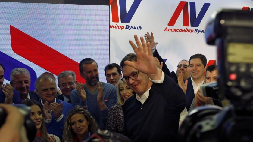Serbian Prime Minister and presidential candidate Aleksandar Vucic, center, celebrates after claimin