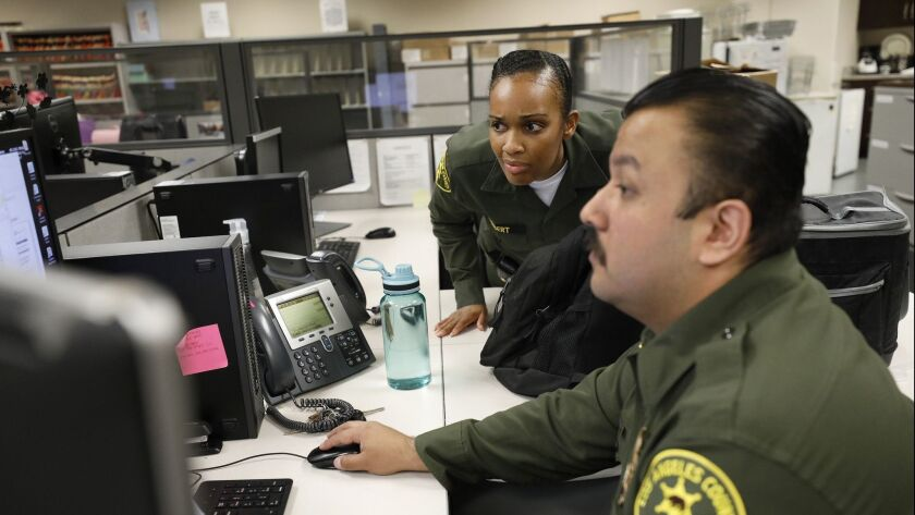 LOS ANGELES, CA - MAY 13, 2019 - Los Angeles County Jail Custody Assistants Alexis Herbert, left, an