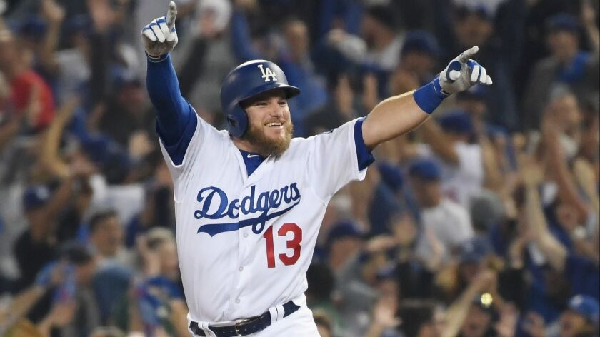 The Dodgers' Max Muncy celebrates his 18th inning walk-off home run to defeat the the Boston Red Sox 3-2 in Game Three of the 2018 World Series at Dodger Stadium on October 26, 2018 in Los Angeles, California.