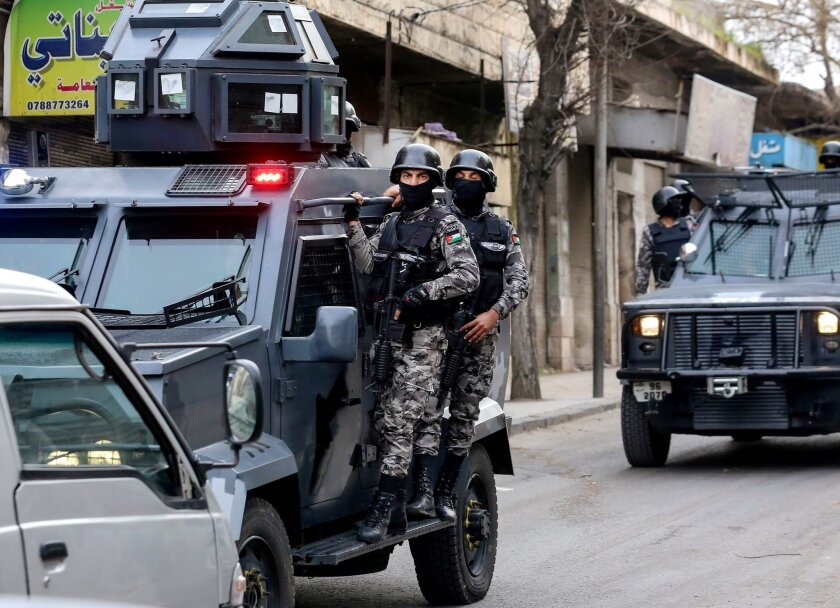 Jordanian security forces secure Hakama street during a raid in downtown Irbid, north of Amman, Jordan, Wednesday, March 2, 2016. Men killed in armed clashes with Jordanian special forces had ties to the Islamic State extremist group and had planned attacks on military and civilian targets in the k