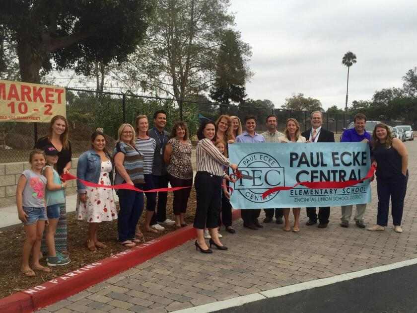Paul Ecke Central principal Adriana Chavarin cuts the ribbon during a celebration of the new safety improvements made around the school. The project makes it safer for families to walk, bike or drive to school.