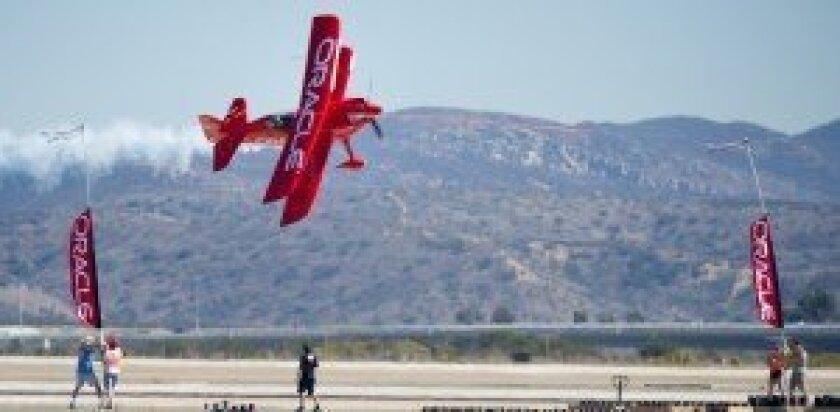 Sean Tucker flying through ribbon at 220 mph