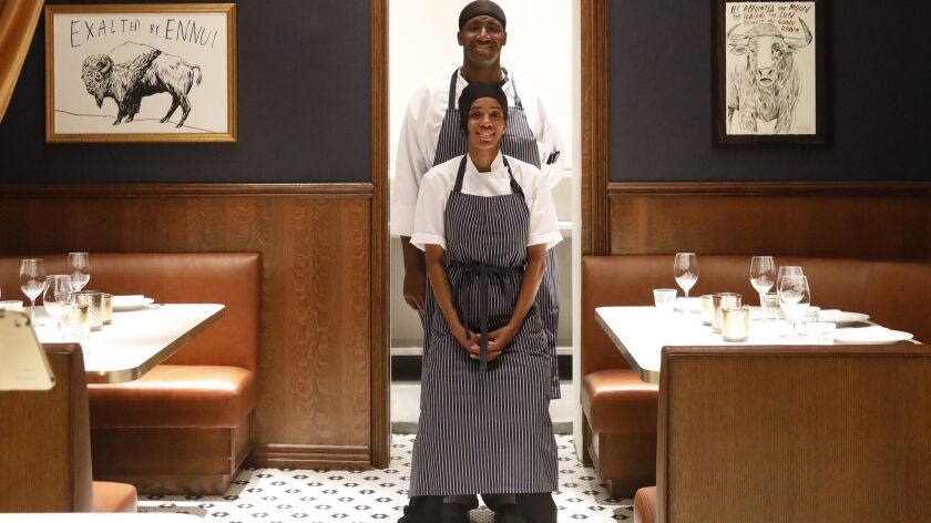 APL cooks Marcus Lewis and Zia Hughes are responsible for the take-away counter at the restaurant.