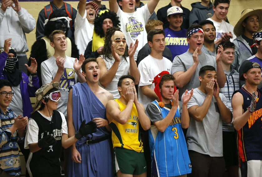 """St. Augustine's student cheering section, called """"The Pit"""" roots for their team as they played against Scripps Ranch."""