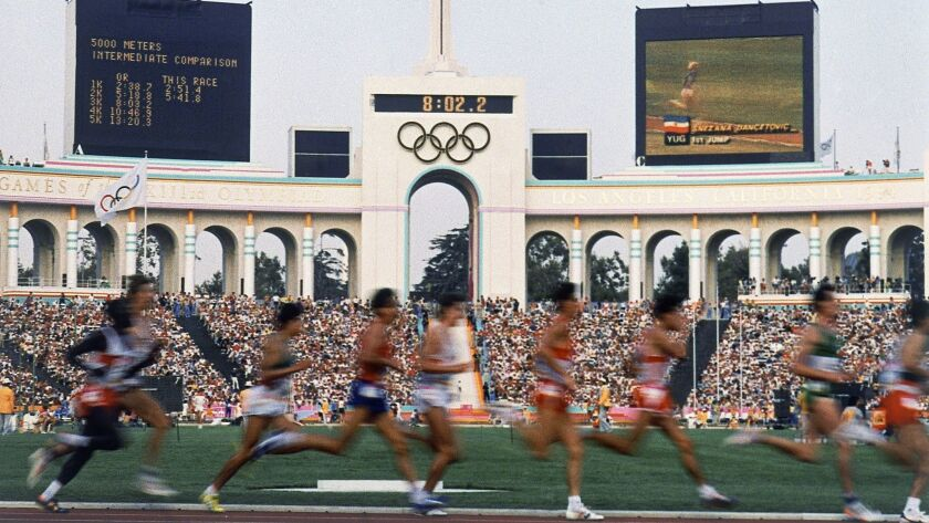Competitors run in the men's 5,000-meter race at the 1984 Olympic Games in Los Angeles.