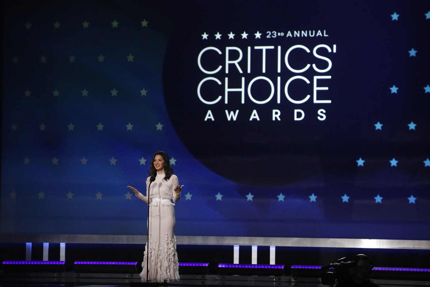 Actress Olivia Munn makes her introduction as host of the 23rd Critics' Choice Awards inside the Barker Hangar in Santa Monica.