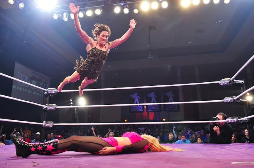 Jungle Grrrl takes flight in her attack on Lana Star during a Women of Wrestling match.