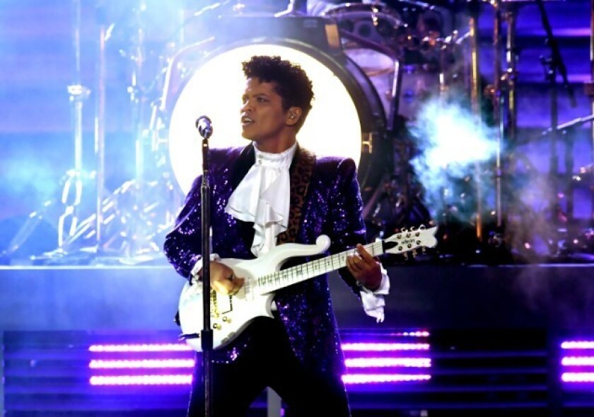 Bruno Mars embodied Prince in a tribute to the Purple One at the 2017 Grammys.