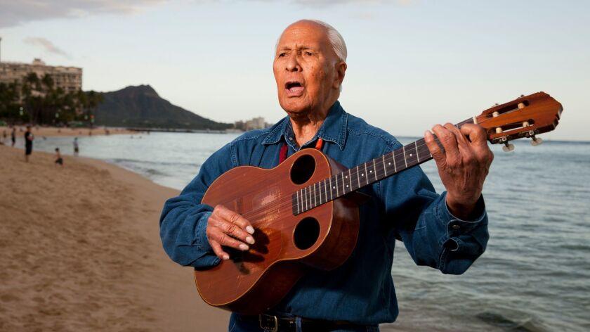 Ukulele legend Eddie Kamae plays a few songs on Waikiki Beach in 2013.
