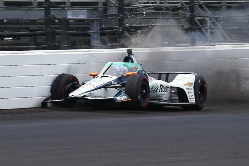 The car driven by Fernando Alonso, of Spain, hits the wall in the fourth turn during practice for the Indianapolis 500 auto race at Indianapolis Motor Speedway in Indianapolis, Thursday, Aug. 13, 2020. (AP Photo/Kirk Stierwalt)