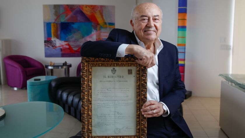 SAN DIEGO, CA Aug. 21st, 2018 | Dr.Andrew Viterbi poses for photos with a document in his La Jolla h