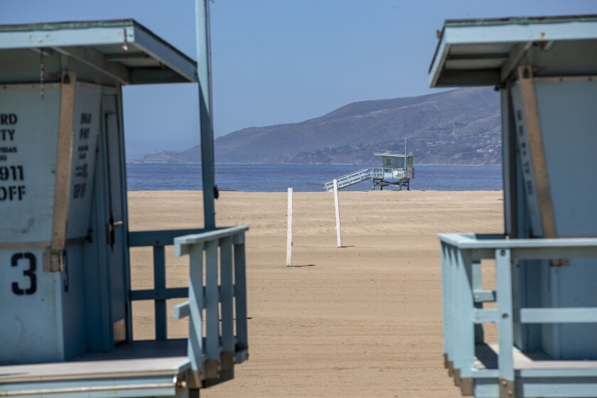MALIBU, CA - APRIL 23: Lifeguard towers sit on an empty Zuma Beach on Thursday, April 23, 2020 in Malibu, CA. To fend off coronavirus contagion, Los Angeles County has kept beaches closed, but hundreds of beachgoers flaunted the rules up and down the coastline from Santa Monica to Malibu. (Brian van der Brug / Los Angeles Times)