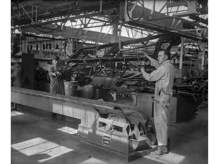 April 21, 1930: Assembly line workers putting first chassis online at Ford plant in Long Beach. This