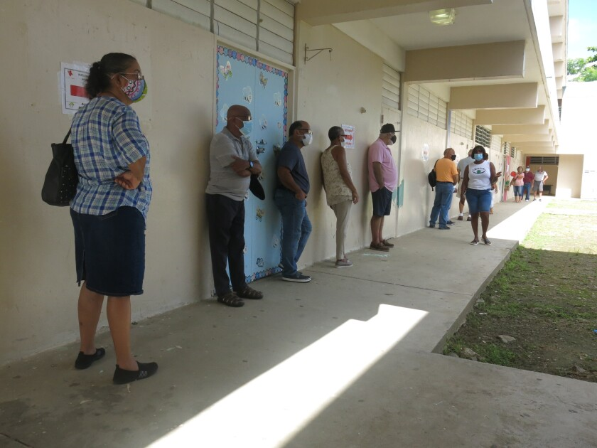 Voters wait to cast their ballots in Loíza, Puerto Rico, on Sunday.