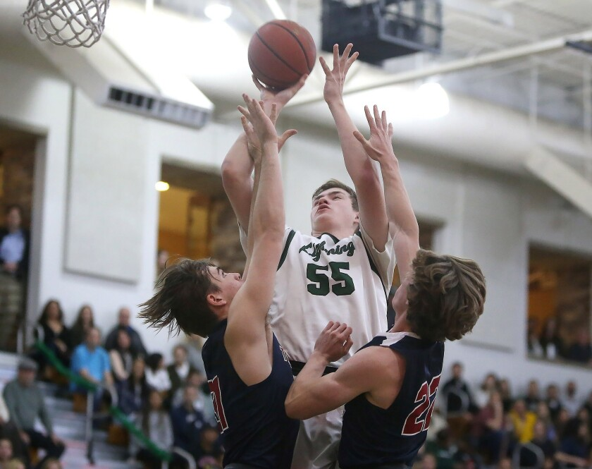 Sage Hill High's Johnny King drives to the hoop for a score between two St. Margaret's defenders in