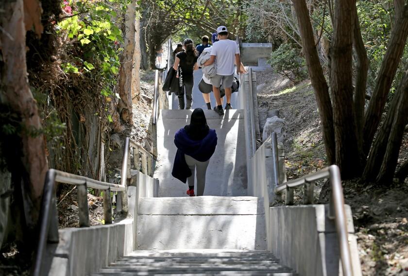 Beachgoers make the steep trek down to Thousand Steps Beach.
