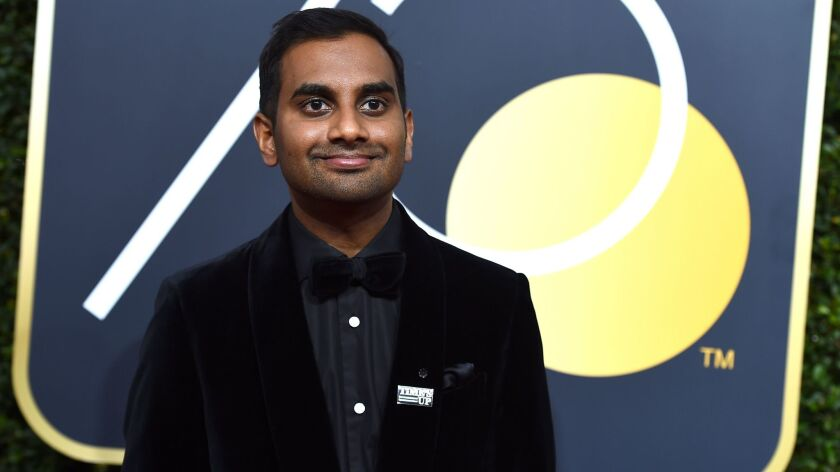 "Aziz Ansari is seen at the Golden Globes in Beverly Hills on Jan. 7 wearing a ""Time's Up"" pin."