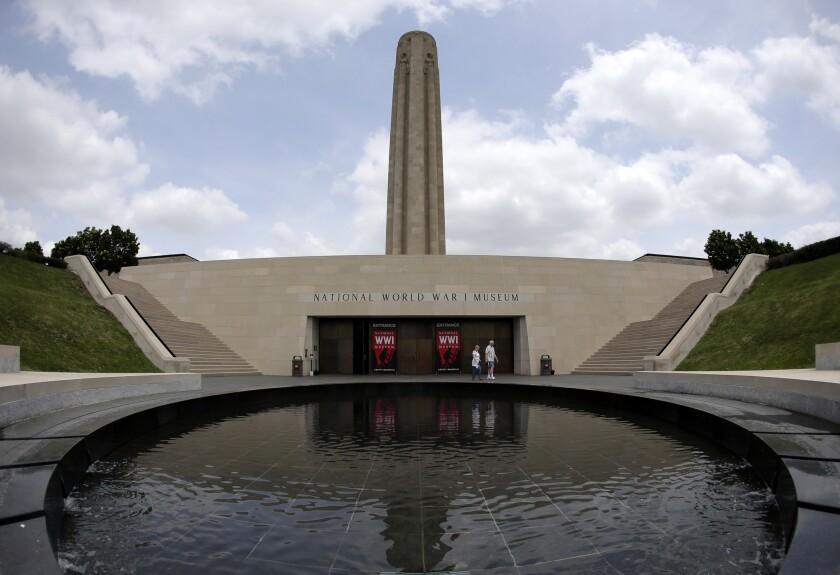 Visitors walk near a reflecting pool outside the main entrance to the National World War I Museum at Liberty Memorial in Kansas City, Mo. The museum focuses on the Great War, which started 100 years ago.