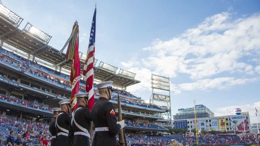 U.S. Marines with Marine Barracks Washington present colors before a baseball game at Nationals Park, Washington, D.C., on July 25. Commandant of the Marine Corps Gen. Robert B. Neller threw the first pitch during the annual Marine Night at the ballpark.