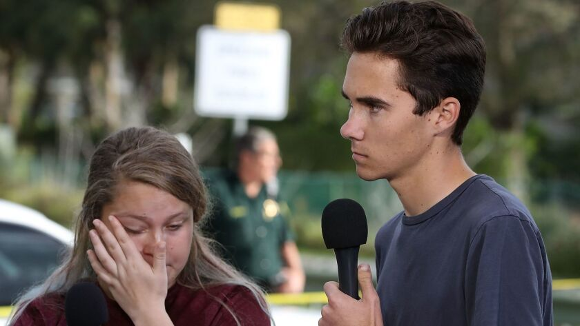 Marjory Stoneman Douglas High School student David Hogg, right, has been the target of attacks accusing him of being an actor.