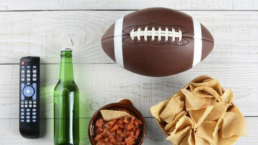 TV remote, beer, salsa, football and chips - and you could probably do without the football. (Scukrov)
