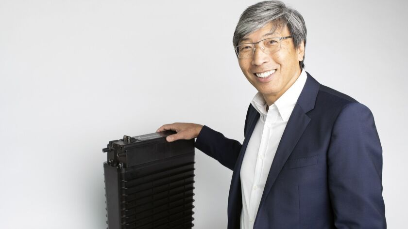 NantEnergy Chairman Patrick Soon-Shiong with his company's rechargeable zinc-air battery cell.