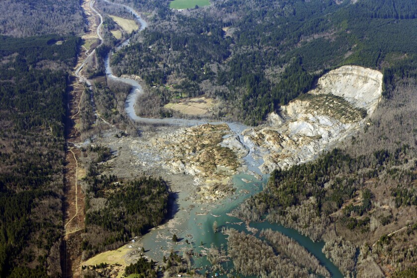 This aerial photo, taken Monday, shows the massive mudslide that killed at least eight people Saturday and left dozens missing near Arlington, Wash.