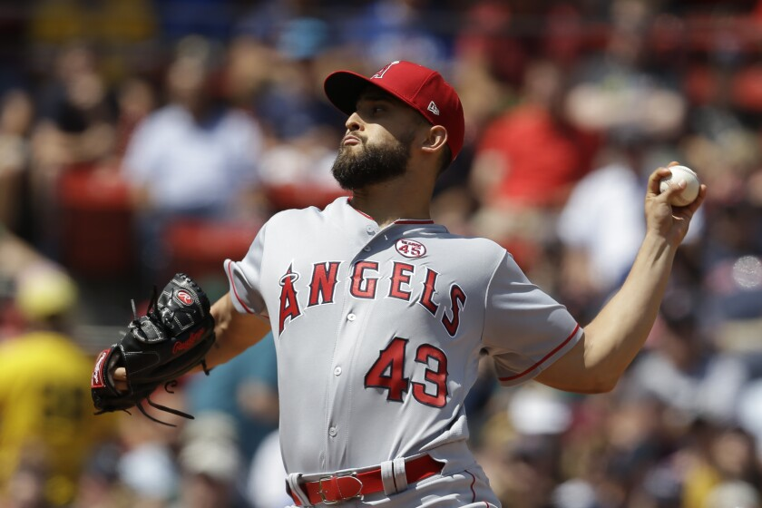 Angels starter Patrick Sandoval delivers against the Boston Red Sox during the first inning of Sunday's game.