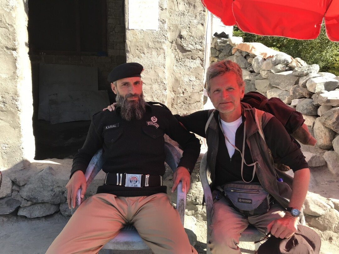 Paul Salopek with a bearded cop at a checkpoint in northern Pakistan.
