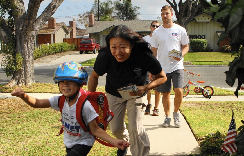 State Senate candidate Janet Nguyen, a Republican, goes door to door while campaigning in Los Alamitos. Her opponent is Democrat Jose Solorio.