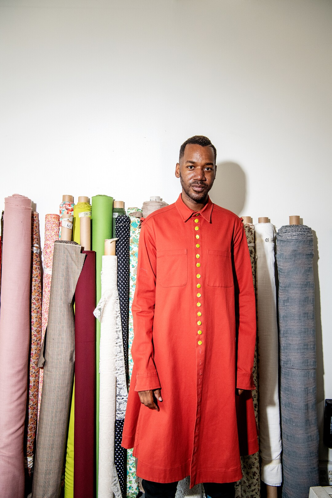 Designer Kenneth Nicholson wears a rust Dorcas Mantle with contrasting velvet buttons.