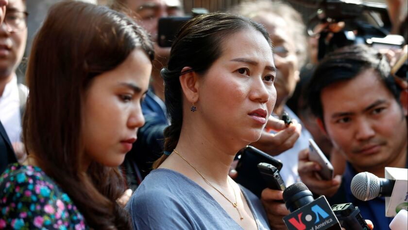 Pan Ei Mon, right, and Chit Su Win, wives of jailed Reuters journalists Wa Lone and Kyaw Soe Oo, talk to reporters outside a court in Yangon, Myanmar, on Jan. 11.